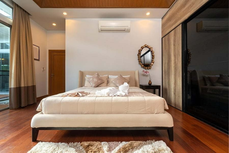 modern-bedroom-with-working-desk-and-bedding